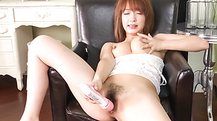Redhead Asian babe make her hairy slit wet