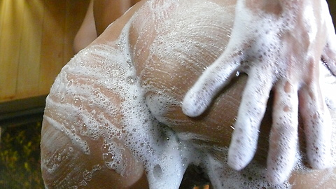 Soapy asian amateur girl Karen Yuuki rubs down her wet body