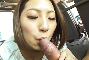 Cutie provides Asian blowjob while on the road