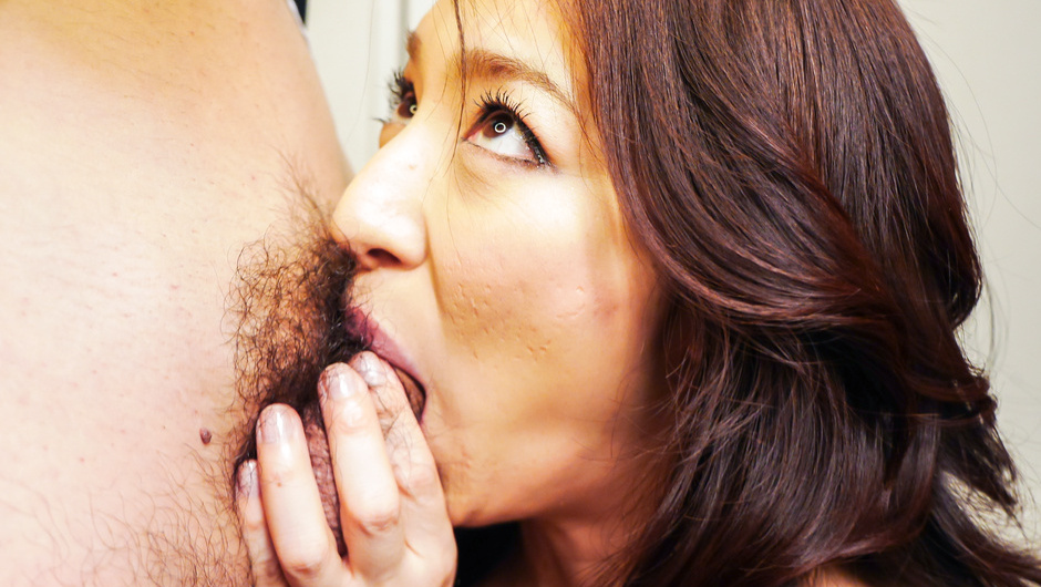 Asian milf goes donw on cock during work hours