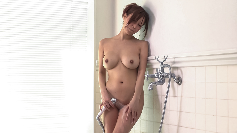 Nude woman plays with the pussy in the shower