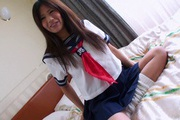 Pretty Yukari teenage school girl stripping off and masturbating Photo 2