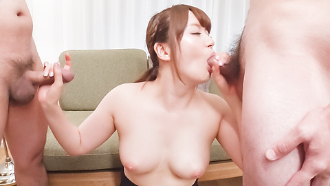 Passionate woman applies sensual blowjob on dicks
