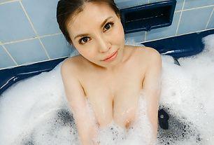 Busty Asian milfgoes nasty on her juicy twat