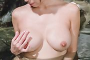 Hot Asian milf plays with her pussy in the water Photo 11