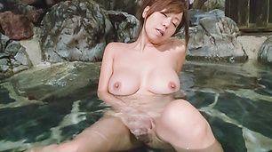 Hot Asian milf plays with her pussy in the water