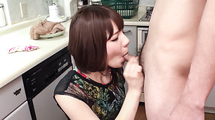 Wife kneels to give Asian blowjob to hubby