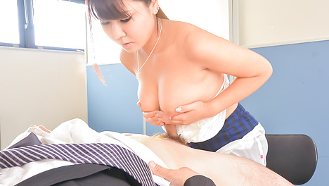 Busty Japanese goes down on a juicy dick