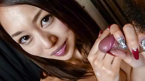 An Yabuki on her knees to give him an asian blowjob