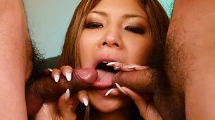 MILF in green Miku Kohinata gives two asian blowjobs