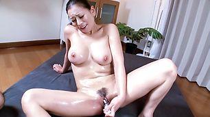 Busty milf enjoys Japan cum over her hairy pussy
