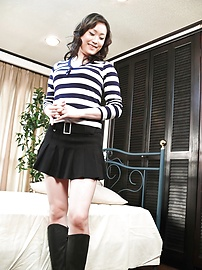 Hitomi Aizawa - Asian hottie Hitomi Aizawa gets nasty with two fat salami - Picture 1