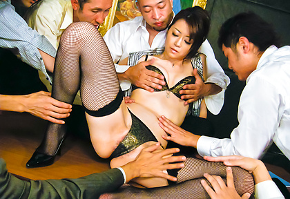 Skinny woman in lingerie and stockings gagging and gang banged