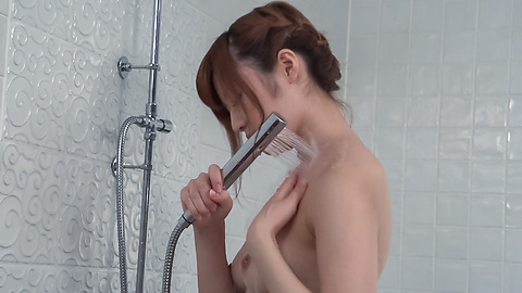 Yumi Maeda - Peachy tits doll uses Japanese vibrator in the tub  - Picture 1