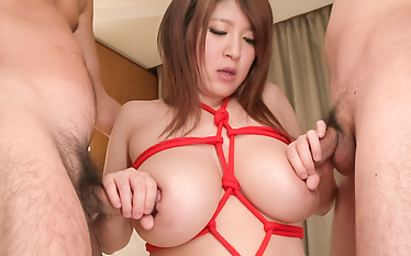 Busty babe gives Japanese blowjob on two dicks